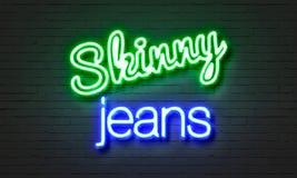 Magert jeansneontecken på bakgrund för tegelstenvägg arkivbilder
