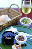 Casual lunch with bread basket, wine and pate Stock Photo