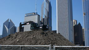 Maggie Daley Park Under Construction. Bulldozer on mound of dirt during construction of Maggie Daley park in Chicago Loop on the Mag Mile with skyline in Royalty Free Stock Photos