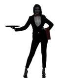 Maggiordomo del cameriere della donna che tiene la siluetta vuota del vassoio Fotografia Stock