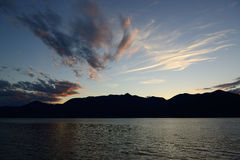 Maggiore lake, sunset from lakefront of Luino Stock Photos