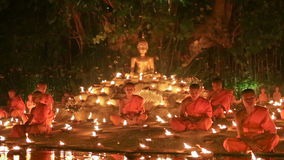 Magha puja day , Chiangmai, Thailand. CHIANG MAI THAILAND - FEBRUARY 22 : Magha puja day is the important incidents Buddhist day. Buddhist monks light the stock footage