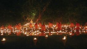 Magha puja day , Chiangmai, Thailand. Magha puja day is the important incidents Buddhist day. Buddhist monks light the candle for buddha in temple ,Chiang mai stock footage