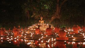 Magha puja day , Chiangmai, Thailand. Magha puja day is the important incidents Buddhist day. Buddhist monks light the candle for buddha in temple ,Chiang mai stock video