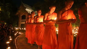 Magha puja day, Monks light the candle for buddha,