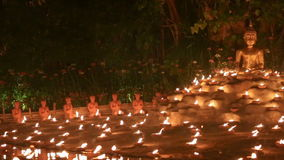 Magha puja day, Monks light the candle for buddha,. Chiangmai,Thailand stock video footage