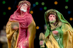 The Magi Caspar and Melchior. Nativity scene. Christmas traditions. Caspar in front of Melchior,  with other figures and colorful stars at background. Nativity Royalty Free Stock Photos