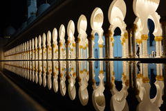 Magiс place. Mosque arches reflected in water Stock Photography
