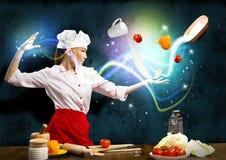 Magia en la cocina fotos de archivo