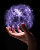 Magic. Hand of a young wizard creating a magical sphere Stock Photo