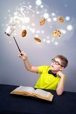 Magic. Little boy doing a magic Royalty Free Stock Image