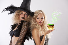 The magic of 2 black witches Royalty Free Stock Photography