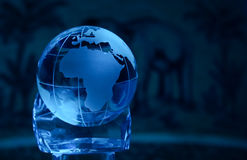 Magic africa. Glass globe in blue on a glass hand showing africa with an elephant and a palm-tree in the background Stock Photography
