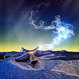 Magic aladdin lamp. Classic aladdin magic lamp in the desert night scene Royalty Free Stock Photo