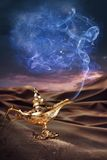 Magic Aladdin's Genie lamp on a desert. Aladdin magic lamp on a desert with smoke royalty free stock image