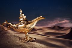 Magic Aladdin's Genie lamp on a desert stock photos