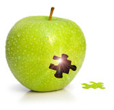 Magic apple. Apple with a hole in the form of a puzzle and a luminescence from within Royalty Free Stock Image