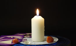 Magic atmosphere. A magical atmosphere with a candle, reading cards tarots, stones and horoscope stock photo