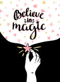 Magic background with stars and hand,  inspiring phrase Believe in magic. Vector design. Space Poster Royalty Free Stock Photography