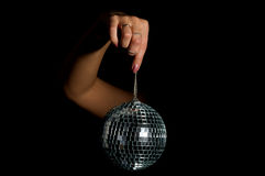 Magic ball. Hand hold magic ball. Isolated image on a black Royalty Free Stock Photo