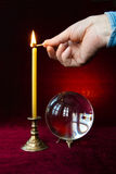 Magic ball and candle. Stock Images
