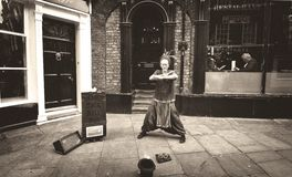 Magic ball performer in the street of York,England. A talented old magic crystal ball performer Stock Photos