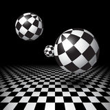 Magic balls over the checkered floor Stock Images