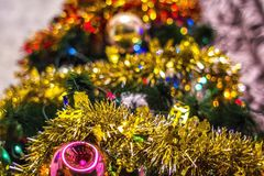 Magic beautiful christmas tree with old fashioned, retro christmas toys close-up and beautiful garland lights Royalty Free Stock Image