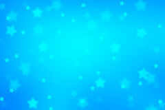 Magic blue colored blurred star shape Xmas background Stock Image