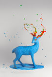 Magic blue deer with multicolor horns Royalty Free Stock Photos