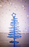 A magic blue metallic modern christmas tree on wood table Stock Photos