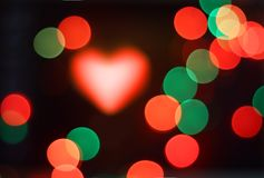 Magic blurred background. Abstract bokeh, magic colorful blurred background with heart Royalty Free Stock Images