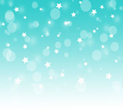 Magic bokeh white star on a blue background Royalty Free Stock Image