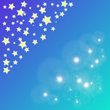 Magic bokeh yellow star on blue background Royalty Free Stock Image