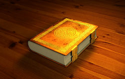 Magic book. Laying on wooden tabletop royalty free illustration