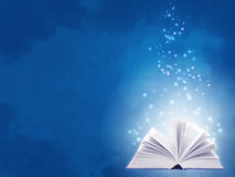 Magic book. Horizontal background of blue color with magic book Stock Image