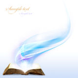 Magic book. Opened magic book with magic light for you design Stock Photo