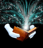 Magic book. In leather-bound held by hands in white gloves Stock Photo