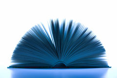 Magic book. Open bound book toned in blue for fairy impression Stock Photo