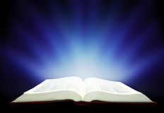 Magic book. Divine radiance book Stock Photos