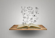 Magic book with business concept and graph Stock Image