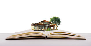 Magic book with house and tree The idea of a small number of people . Royalty Free Stock Photo