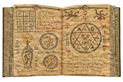 Magic book isolated 1. Old magic book with magic mystic symbols and drawings, watercolor illustration, collage Royalty Free Stock Image
