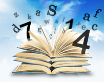The Magic Book and the letters Royalty Free Stock Photo