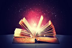 Magic book open. And the light from it Royalty Free Stock Photography