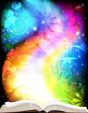 Magic book. Open book of fairy tales on a rainbow floral background vector illustration
