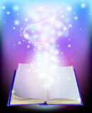 Magic book. With rays of light Stock Photos