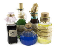 Magic bottles. Glass bottles with potion and magic beverages isolated on white stock photo