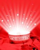 Magic bowl. On red velvet cloth Royalty Free Stock Photos