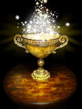 Magic bowl. A tortoise shell colored chalice with handles on a wooden table with stars flowing.  Concept for the unknown or future Royalty Free Stock Photos